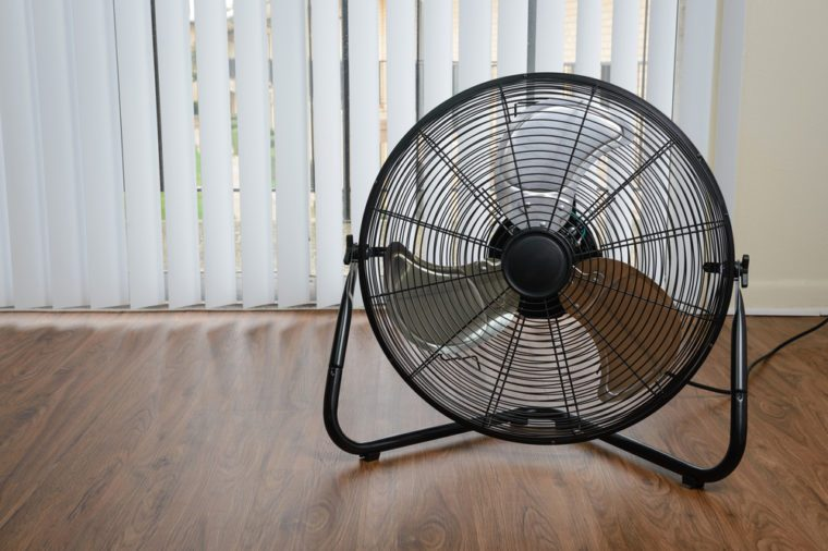 black metal ventilation fan on wooden floor