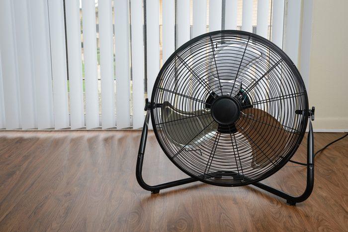 black metal ventilation fan on wooden floor