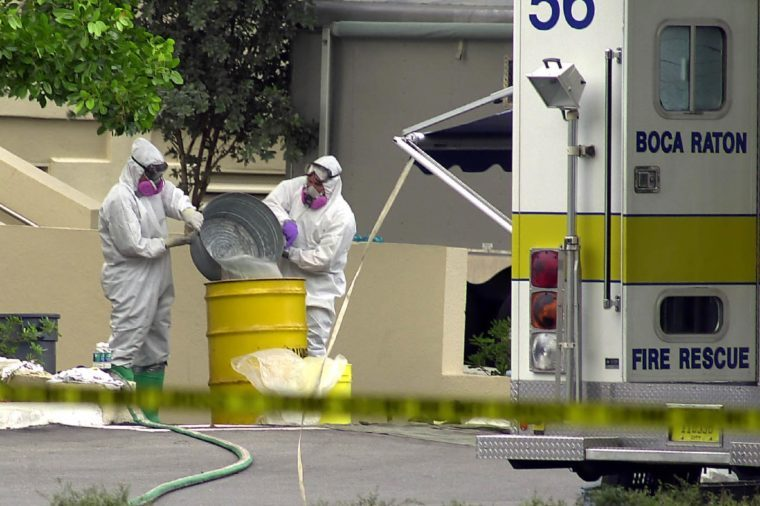 FBI FBI agents wearing bio hazard suits pour liquid into a yellow drum outside the American Media Inc. building in Boca Raton, Fla., . FBI and local law enforcement closed building which houses the offices of several supermarket tabloids. The Anthrax virus was found in an employee's nose and on a computer keyboard Monday, Oct. 8, 2001, after a photo editor for the company died Friday of the rare disease. All 300 people who work in the building and anyone who spent more than an hour inside since Aug. 1 were advised to visit health officials