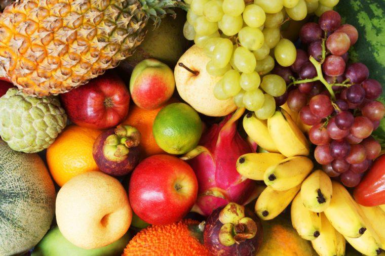 Fruit background, many fresh fruits mixed together