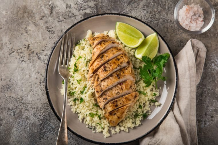 grilled chicken breast with couscous, top view