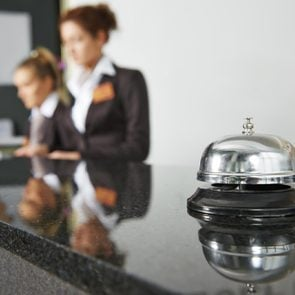 Modern luxury hotel reception counter desk with bell