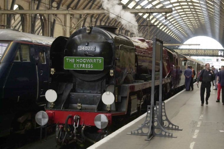 J.k (joanne) Rowling And The Hogwarts Express At Kings Cross Station For The Launch Of The New Harry Potter Book - J.k. Rowling And Her Minders Arrive For The Hogwart Express At King's Cross Station For The Launch Of The New Harry Potter Book - The Creator Of Publishing Phenomenon Harry Potter Is Being Protected 24 Hours A Day From A Male Stalker Who Has Showered Her With Love Letters And Been Seen Standing Outside Her Home - Two Female Bodyguards Have Been Assigned To Jk Rowling While She Promotes Her Fourth Harry Potter Book Which Began Shattering Publishing Records From The Moment It Was Released At Midnight On Friday - The Fan Understood To Be A Scottish Teacher In His 30s Has Not Made Any Specific Threats To The Millionaire Author - But His Obsessive Behaviour Has Alarmed Her Advisers And Private Security Personnel Will Accompany The 34 Year Old Writer On Her Four-day Round Britain Tour In A Steam Train - Ms Rowling Look Tired And Anxious As She Set Off From Londonn On The Hogwarts Express - Named After The Special Train Which Takes Trainee Wizard Harry On His Adventures And Which As In The Books Departed From Platform 9 At Kings Cross - It Should Have Been A Triumphal Departure - The First British And Us Print Run Of 5.3 Million Copies Of Harry Potter And The Goblet Of Fire Has Amazon Internet Bookselling Site Totted Up 370 000 Sales - More Than Six Times The Record Set In March By John Grisham's The Brethren - Ms Rowling A Single Mother With An Eight Year Old Daughter Who Was Penniless Three Years Ago Can Expect To Earn A60 Million From The New Book On Top Of Royalties From The 30 Million Sales Of The First Three Which Have Been Translated Into 31 Languages.