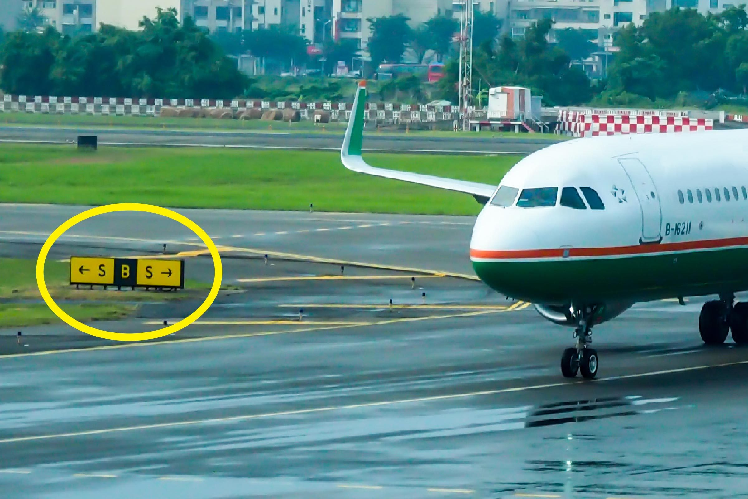 Kaohsiung , Taiwan - OCT 03 , 2017 : Evaair aircraft landed and drive in taxiway at Kaohsiung international airport , view from terminal