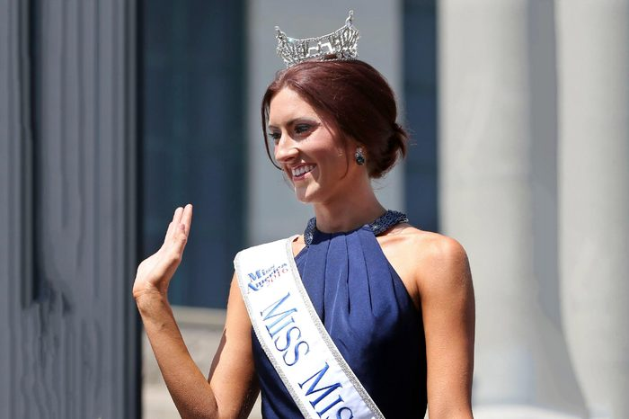 Miss Missouri, Erin O'Flaherty waves as she is introduced during Miss America Pageant arrival ceremonies, in Atlantic City. The contestants from all 50 states, the District of Columbia and Puerto Rico were welcomed to the city Tuesday afternoon to kick off two weeks that will culminate in the crowning of the 2017 Miss America on Sept. 11