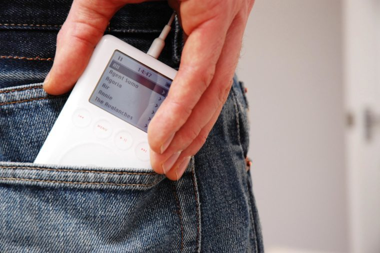 Model Released - Apple iPod in pocket of a man's jeans UK 2000's