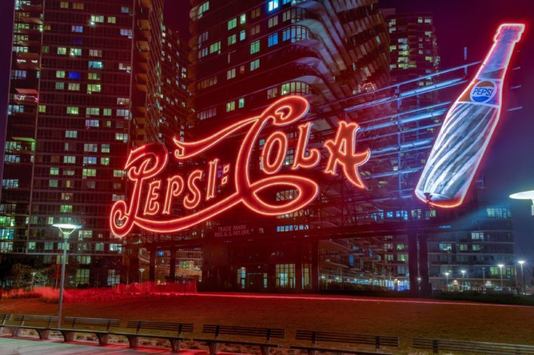 New York City - January 2, 2016: PepsiCola sign and Queensboro Bridge at night as seen from Gantry Plaza, Long Island.