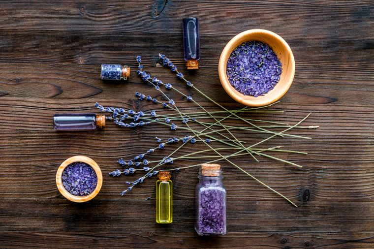 organic cosmetics with lavender on wooden background top view