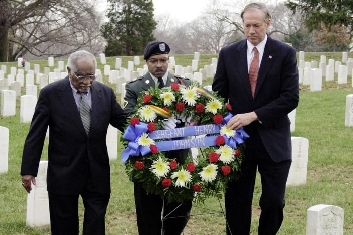 PATAKI JOHNSON JILLIARD New York Gov. George Pataki, right, along with Herman Johnson, left, and Pfc Gerald Jilliard of the New York Army National Guard, prepare to place a wreath at the gravesite of Johnson's father, World War I hero Sgt. Henry Johnson at Arlington National Cemetery in Arlington, Va. . The wreath laying was to honor Sgt. Johnson, a famed member of the Harlem Hellfighters