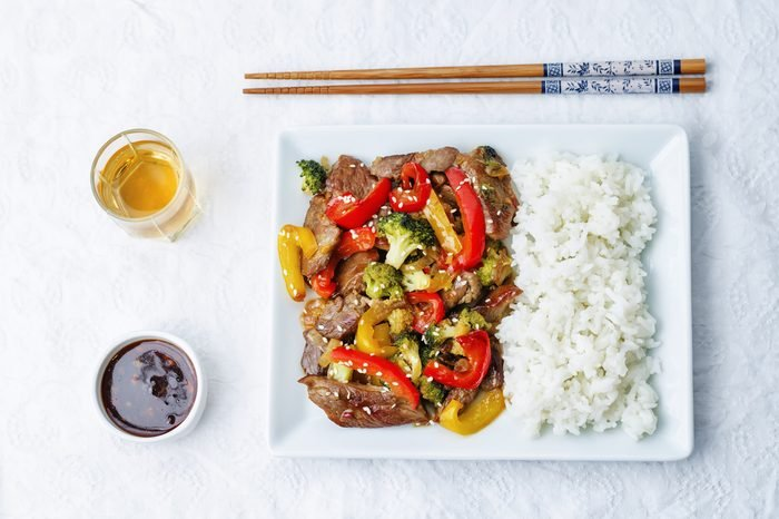 pepper broccoli beef stir fry on a white background. the toning. selective focus
