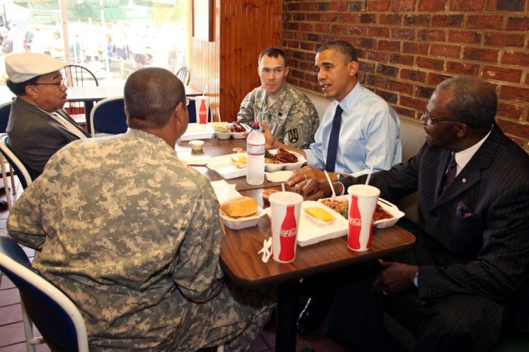 President Barack Obama having lunch with members of the armed services and local barbers at Kenny's BBQ on Capitol Hill in celebration of Father's Day, Washington DC, America