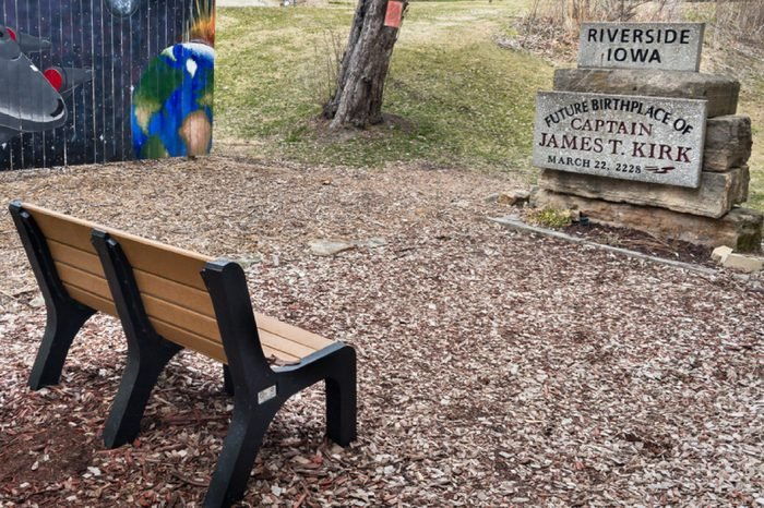 """RIVERSIDE, IA/USA - APRIL 8. 2018: """"Future Birthplace of Captain James T. Kirk"""" (a.k.a. William Shatner) and the Enterprise NCC-1701 from the TV science fiction series """"Star Trek"""" tribute."""