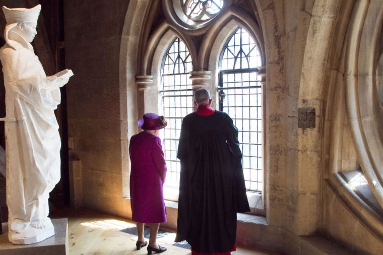 Queen Elizabeth II is shown around the Gallery by The Very Reverend John Hall.