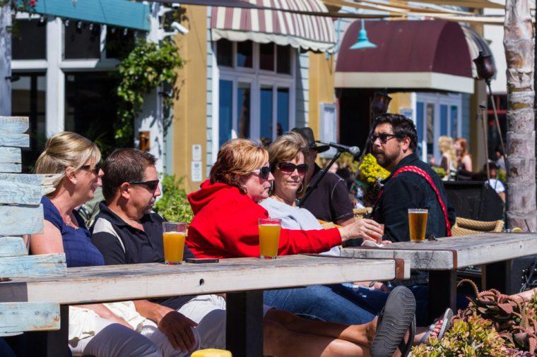 San Luis Obispo, California - May 03 :Adults enjoying an adult beverage at a beach front bar, May 03 2015 San Luis Obispo, California.