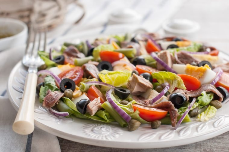 Nicoise salad. Nicoise salad with tuna, cherry tomatoes, eggs, lettuce, anchovy, red onion and capers. Food and drink.