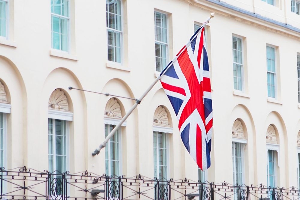 British flag flying on the balcony of a historic building in central London