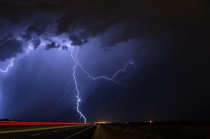 Lightning strikes during a nighttime thunderstorm.