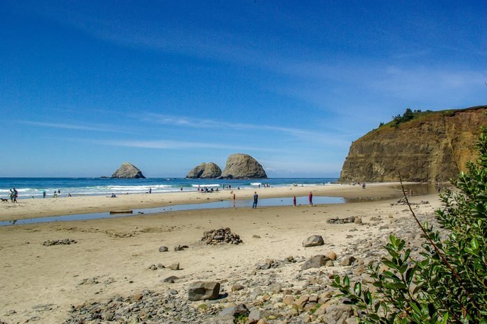 Landscape of tourists playing on Rockaway Beach on the Oregon coast near Tillamook