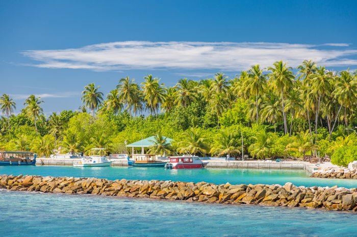 Dhigurah island, Maldives. December 15. 2015: Maldives local island and harbor with boats and trading carts. Tropical harborDhigurah island, Maldives. December 15. 2015: Maldives local island and harbor with boats and trading carts. Tropical harbor