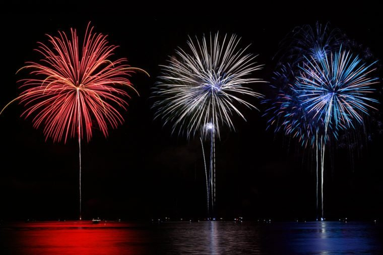 Red, White, & Blue Fireworks reflecting in lake