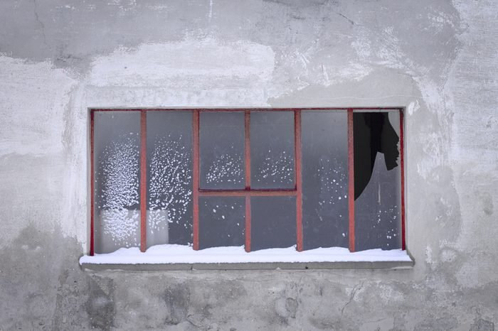 Isolated broken window with snow (Pesaro, Italy)
