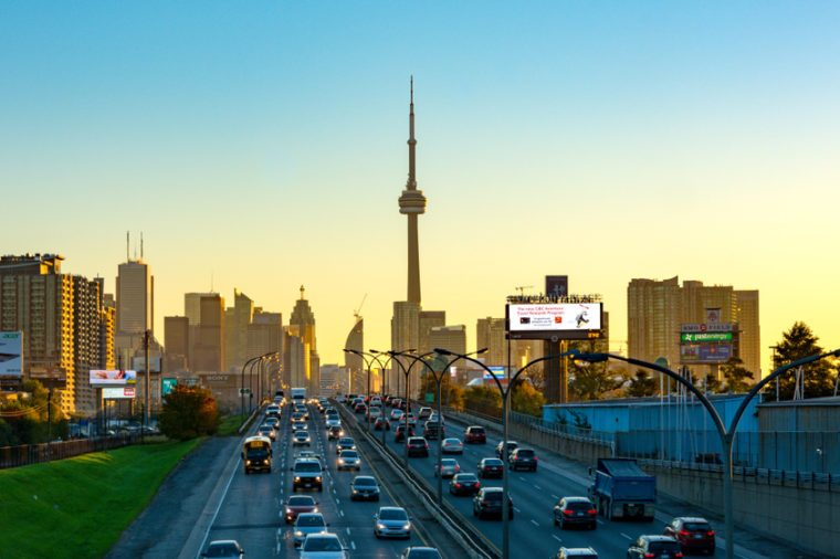 Toronto, Canada- July 12, 2017: City skyline including the CN Tower during dawn. Point of view from the Gardiner Expressway which is one of the most important urban roads in the city