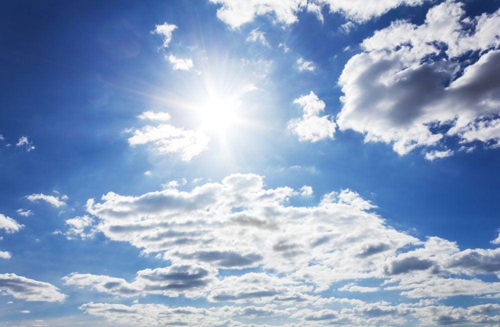 Sun in blue sky with cloud