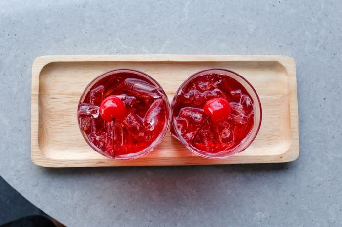 Welcome drink, red fruit mixed with soda and ice to quench thirst on hot days on the table.
