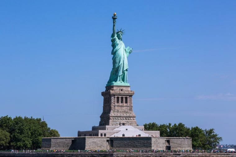 View of the Liberty Statue on the Liberty Island in the Upper New York Hudson Bay on a sunny summer day.