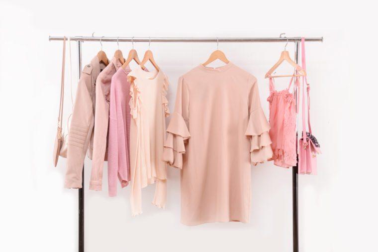 female shirt and sundress clothes,jacket,vest handbag on hanger