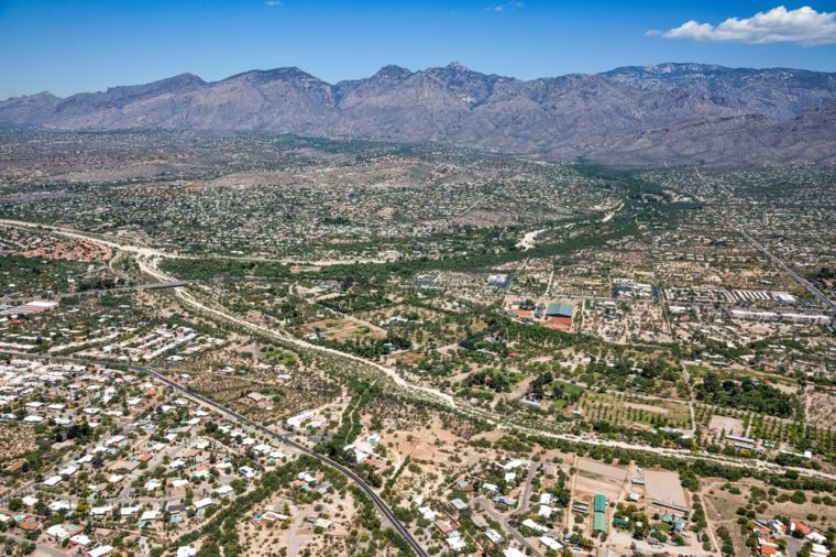 Sabino Creek and Tanque Verde Creek viewed from above with the Santa Catalina Mountains spanning the horizon