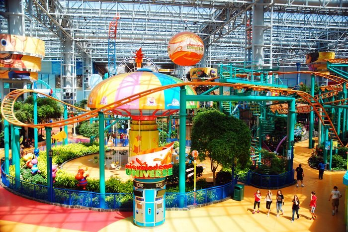 Bloomington, MN, USA May 14, 2013 Teenage friends stroll around the indoor amusement park in the Mall of America in Bloomington, Minnesota