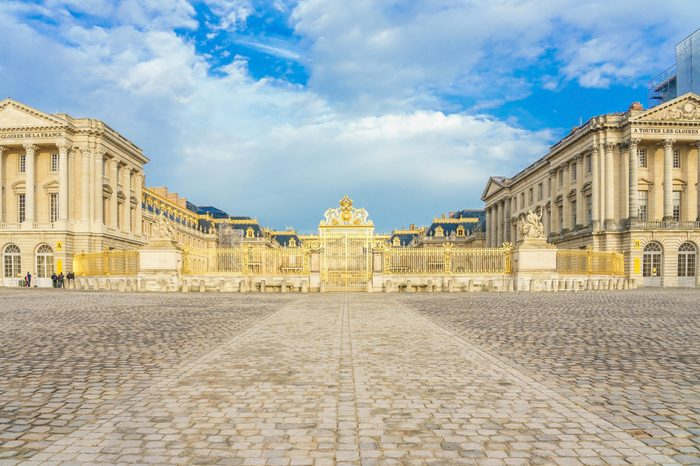 Main entrance of Versailles Palace, Versailles, France on april 08, 2018. Palace Versailles was a royal chateau. It was added to UNESCO list of World Heritage Site