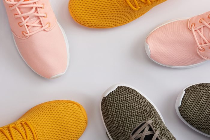 Pattern from colorful sport shoes on white background
