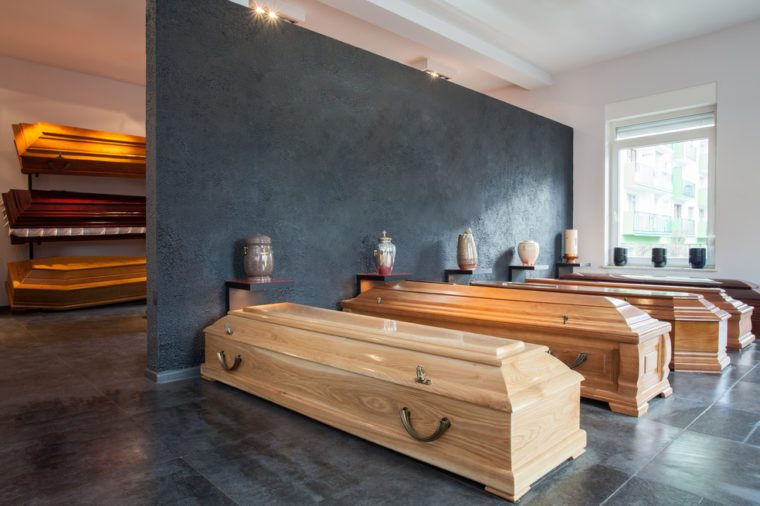 Coffins standing in funeral house