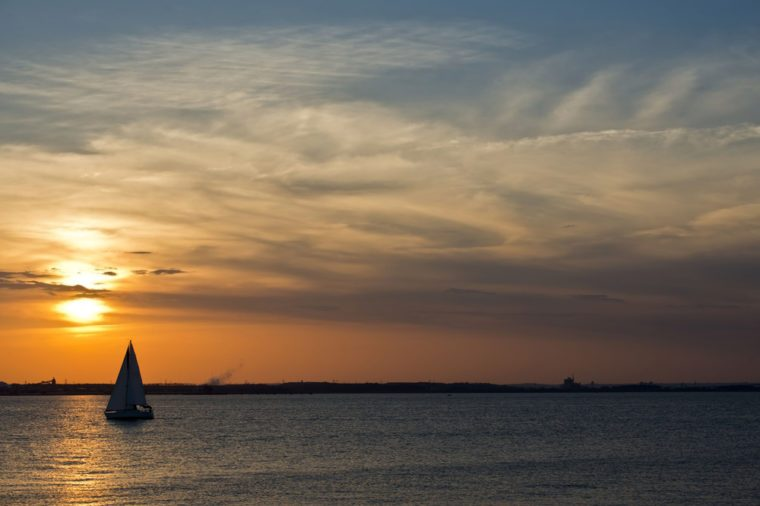 A sailboat on the Chesapeake bay in Maryland at sunset