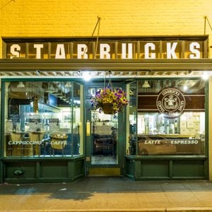 SEATTLE - JULY 5: Original Starbucks store at 1912 Pike Place on July 5, 2014 in Seattle. Serving coffe in 20.891 stores in 62 countries, Starbucks is world's largest coffeehouse company.
