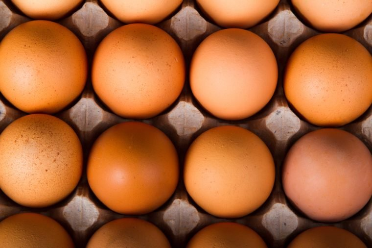 Brown chicken eggs in the package. Top view