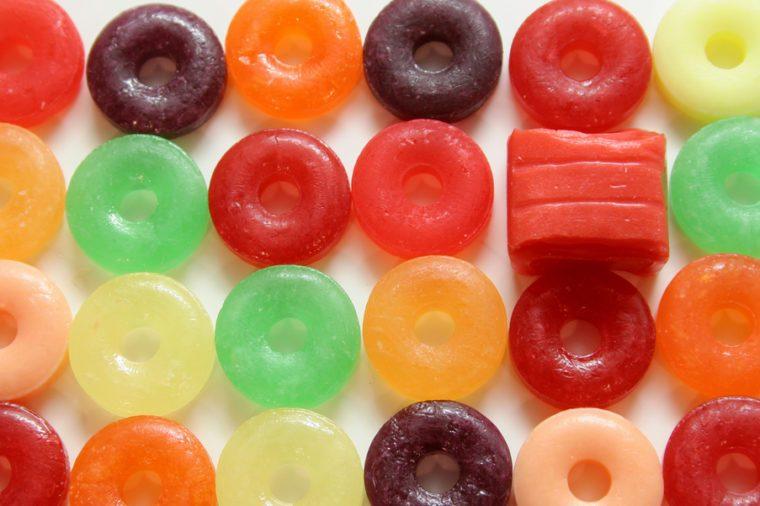 One square candy in colorful array of round candies