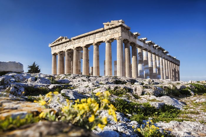 Parthenon temple with spring flowers on the Acropolis in Athens, Greece