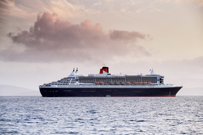 OBAN, ARGYLL AND BUTE, SCOTLAND - MAY 22, 2015: RMS Queen Mary 2, anchored off Maiden Island on May 22, 2015 in Oban, Argyll and Bute, Scotland.