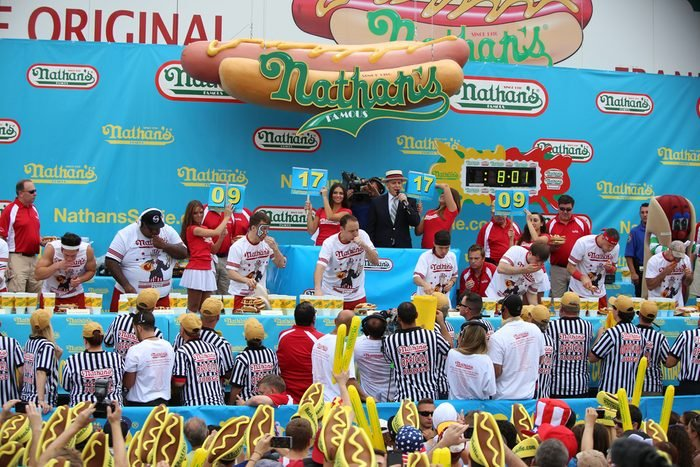 Nathan's Famous staged their annual fourth of July hot dog eating contest in Coney Island, Brooklyn. Promoter & MC George Shea tosses tee shirts to audience