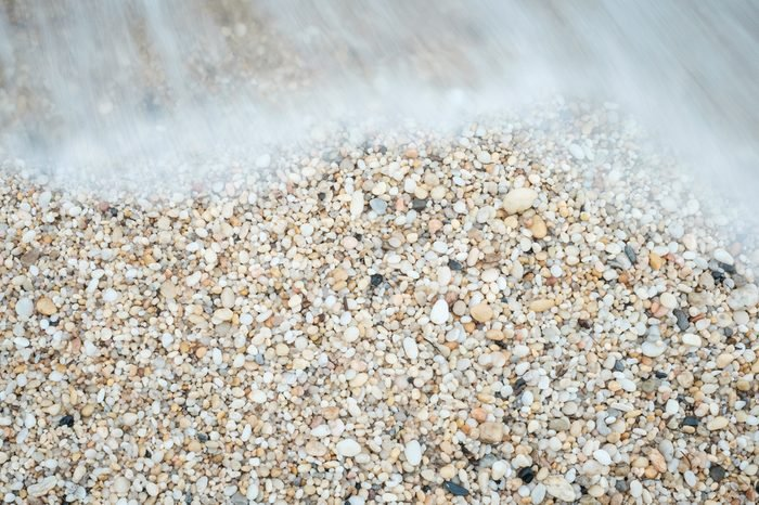 Cape May Diamonds and small smooth pebbles at the tide line on a beach