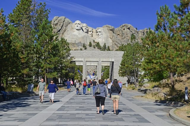 RAPID CITY, SOUTH DAKOTA, CIRCA SEPTEMBER 2015. Tourists enter the Mount Rushmore National Memorial, one of the most popular attractions in South Dakota and in the United States.