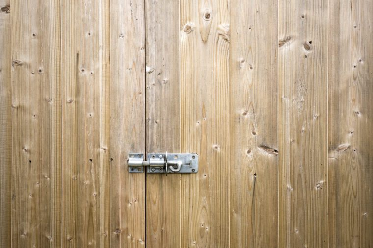 Wooden shed door with locking bolt