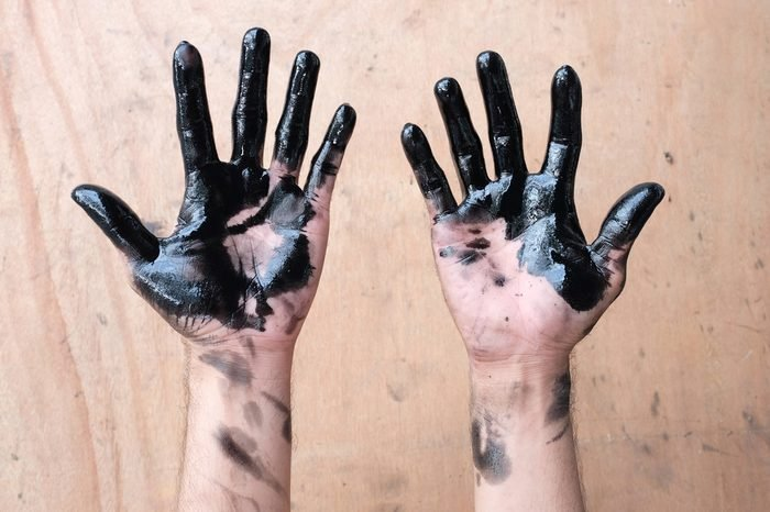 hands of car oil change