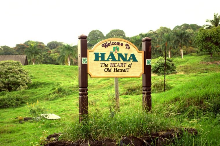 Sign welcoming visitors to the historic town of Hana following a winding scenic drive along Maui's coast.