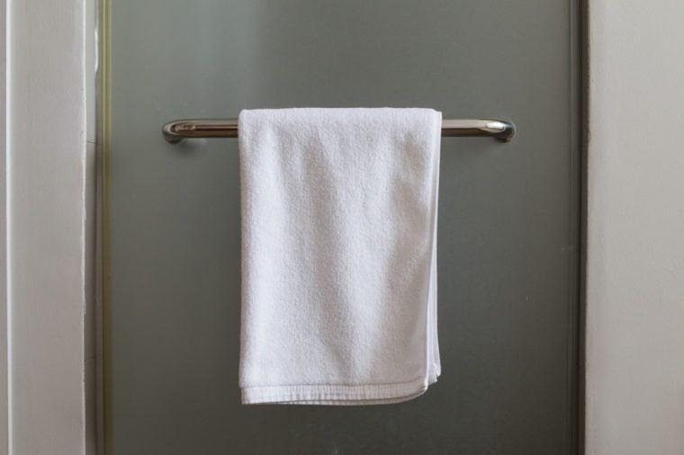 Towel hanging at mirror door in the bathroom.