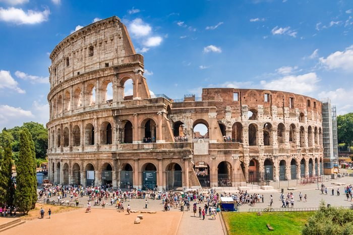 Colosseum with clear blue sky and clouds, Rome,Italy. Rome architecture and landmark. Rome Colosseum is one of the best known monuments of Rome and Italy