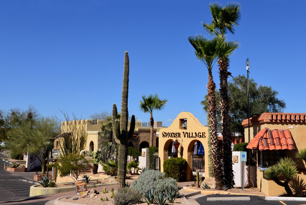 CAREFREE, AZ, USA - FEB 22, 2016: Entrance to the Spanish Village, a period looking shopping area in Carefree, Arizona, with local cactus and other vegetation.